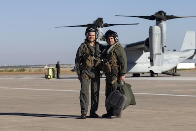 Major Gen. Russell A. Sanborn, left, the commander of Marine Forces Europe and Africa, poses with Maj. Pascal J. Gonzalez, a MV-22B Osprey pilot assigned to Special Purpose Marine Air-Ground Task Force-Crisis Response-Africa, at Morón Air Base, Spain, Aug. 9, 2017. SPMAGTF-CR-AF deployed to conduct limited crisis-response and theater-security operations in Europe and North Africa. (U.S. Marine Corps Photo by 1st Lt. Alexandra Bello)