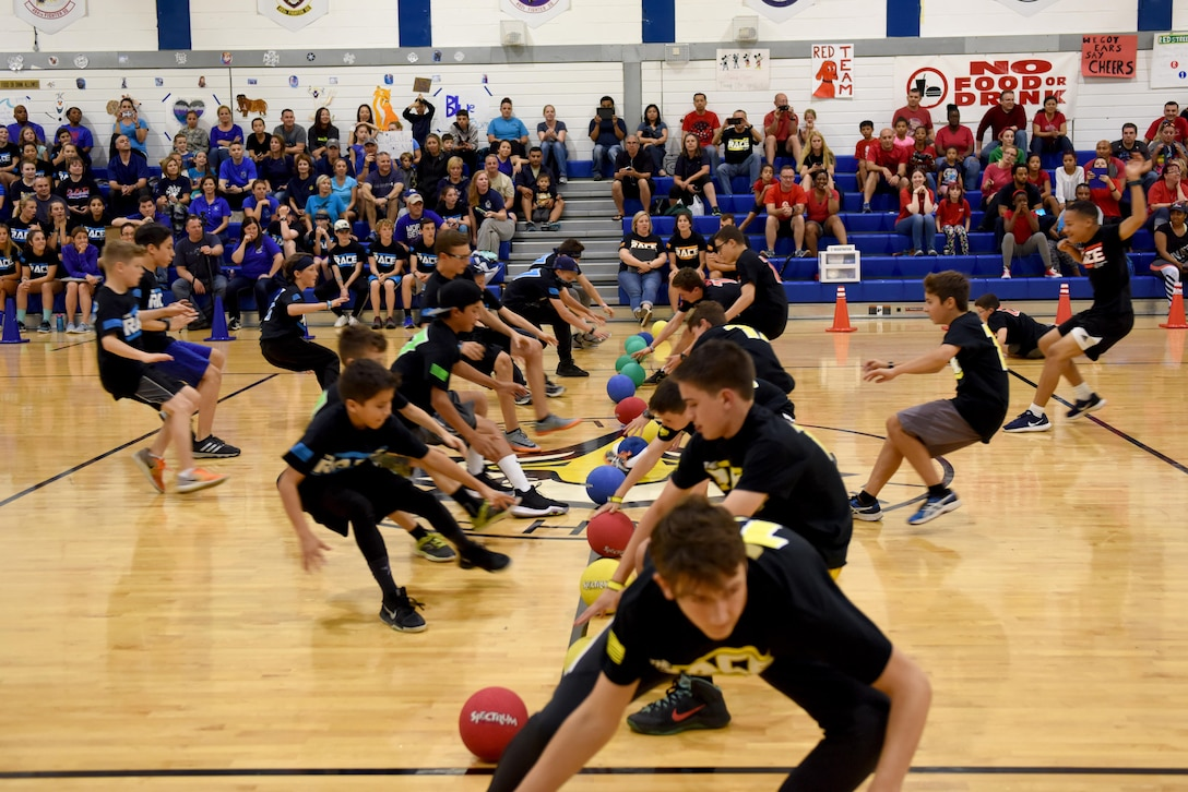 Students speed to the starting line in a game of dodgeball during 'The RACE' at Royal Air Force Lakenheath, England, Aug. 14, 2017. Students and their families participated in various events from dodgeball to dance-offs. (U.S. Air Force photo by Airman 1st Class John A. Crawford)