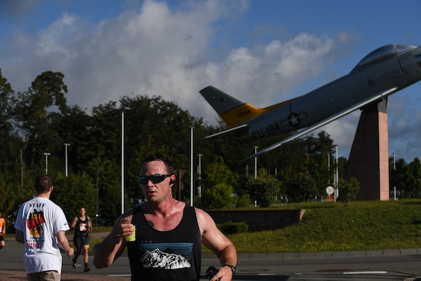 A Kaiserslautern Military Community member drinks water while completing the 7th annual Ramstein Half Marathon at Ramstein Air Base, Germany, Aug. 19, 2017