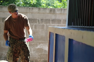 A U.S. Navy Sailor  paints a wall at Claudia Barrera Elementary School, during a Southern Partnership Station 17 community relations project in Honduras.