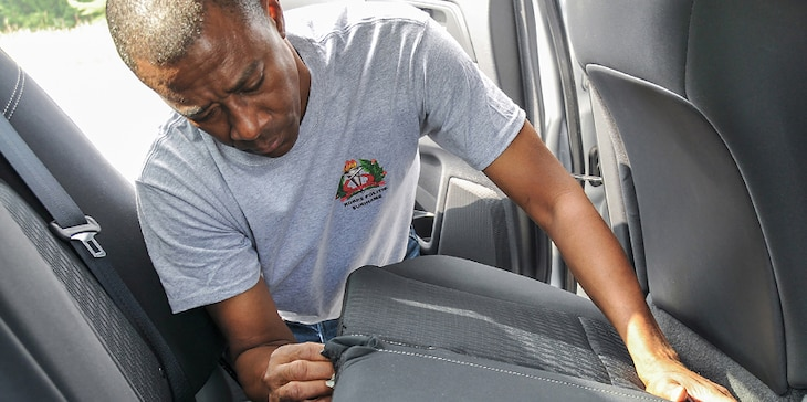 Allentown, PA - Errol, a police inspector from Suriname, searches a car for hidden mock kilos of heroin during the Disrupting Illicit Trafficking Networks course July 26, 2017, at the Northeast Counterdrug Training Center in Pennsylvania.