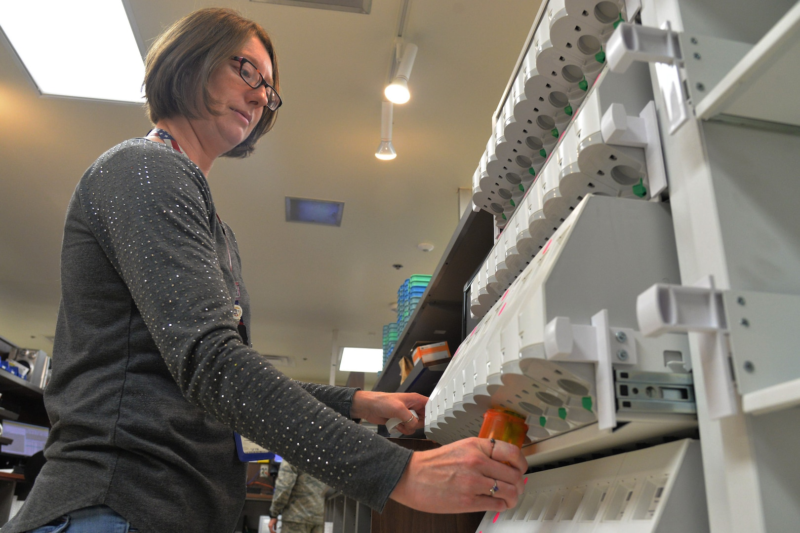 Jessica Gaines, 341st Medical Support Squadron pharmacy technician, fills a prescription using an automated drug dispensing cabinet Aug. 14, 2017, at Malmstrom Air Force Base, Mont.