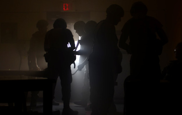 """Airmen assigned to the 28th Civil Engineer Squadron perform triage and extract """"casualties"""" from a hostile environment during the Prime Base Engineer Emergency Force (BEEF) challenge at Ellsworth Air Force Base, S.D., Aug. 17, 2017"""