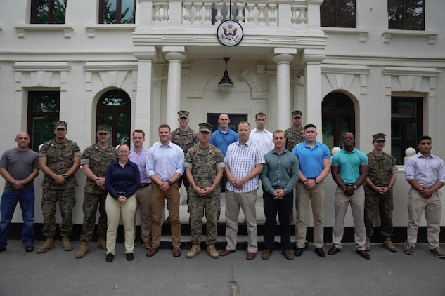 U.S. Marines and sailor with Black Sea Rotational Force 17.1 and Marine Rotational Force Europe 17.1 pose in front of the U.S. Embassy Chisinau with embassy personnel in Chisinau, Moldova, July 15, 2017. (U.S. Marine Corps photo by Sgt. Patricia A. Morris)