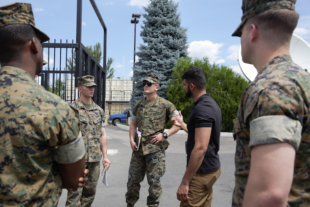 U.S. Marines and sailor with Black Sea Rotational Force 17.1 and Marine Rotational Force Europe 17.1 tour the embassy compound with the assistant regional security officer during an embassy reinforcement exercise in Chisinau, Moldova, July 15, 2017. Embassy reinforcement exercises improve emergency preparedness.  (U.S. Marine Corps photo by Sgt. Patricia A. Morris)