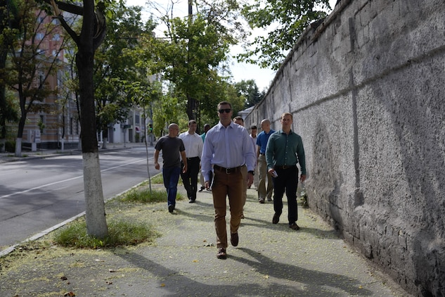 U.S. Marines with Black Sea Rotational Force 17.1, Marine Rotational Force Europe 17.1 and Marine Security Guard detachment tour the adjacent neighborhoods to the U.S. Embassy during an embassy reinforcement exercise in Chisinau, Moldova, July 16, 2017.  Embassy reinforcement exercises improve emergency preparedness.  (U.S. Marine Corps photo by Sgt. Patricia A. Morris)
