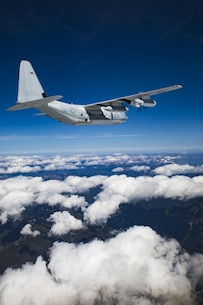 A U.S. Marine Corps KC-130J Hercules aircraft with Marine Aerial Refueler Transport Squadron (VMGR) 352, conducts division tactical navigation training with VMGR-152 as part of unit-level training Evergreen at Naval Air Station Whidbey Island, Washington, Aug. 18, 2017. Division tactical navigation training allows the squadrons' aircraft to perform gear drops in close proximity to a single location, which enhances operational efficiency. Evergreen will serve as VMGR-152's 2017 Marine Corps Combat Readiness Evaluation through tri-lateral training with the U.S. Army 160th Special operations Aviation Regiment and U.S. Army 1st Special Forces Group to gain valuable insight on the most recent Operation Inherent Resolve assault-support tactics. (U.S. Marine Corps photo by Cpl. Joseph Abrego)