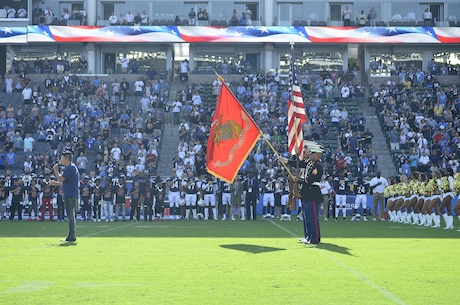 U.S. Marines of Marine Corps Recruiting Station Orange County present the colors during the National Anthem presentation at the Stub Hub Center in Carson, Calif., Aug. 20, 2017. The Color Guard supported the Los Angeles Chargers vs. the New Orleans Saints pre-season game to show support for their local football team and more importantly the community. (U.S. Marine Corps photo by Sgt. Jessica Quezada)