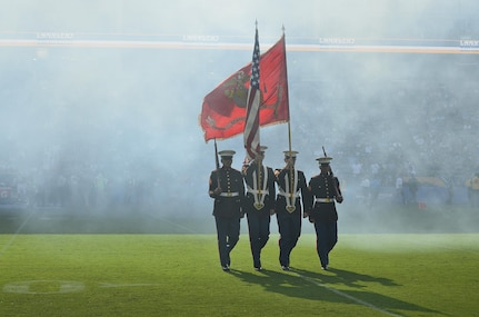 From left to right, Marine Corps Sgt. Herbert Cosio, Sgt. Austin Elder, Sgt. Michael Thomas and Sgt. Martin Minner retire the colors during a Los Angeles Chargers and New Orleans Saints pre-season game at the Stub Hub Center in Carson, Calif., Aug. 20, 2017. Marines of Marine Corps Recruiting Station Orange County presented a Color Guard for their local football team to support the players and more importantly the community. (U.S. Marine Corps photo by Sgt. Jessica Quezada)