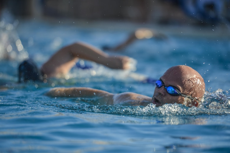 A Team Luke triathlon participant swims during the Luke Triathlon held at Luke Air Force Base, Ariz., Aug. 19, 2017. Athletes participating in the triathlon had to swim a total of 400 meters before moving onto the next segment of the competition. (U.S. Air Force photo/Airman 1st Class Caleb Worpel)