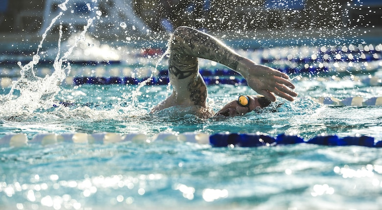 A Team Luke triathlon participant swims during the Luke Triathlon at Luke Air Force Base, Ariz., Aug. 19, 2017. Approximately 70 people participated in the event which included a 400 meter swim, 13 mile bike ride and 3.1 mile run to cross the finish line. (U.S. Air Force photo/Airman 1st Class Caleb Worpel)