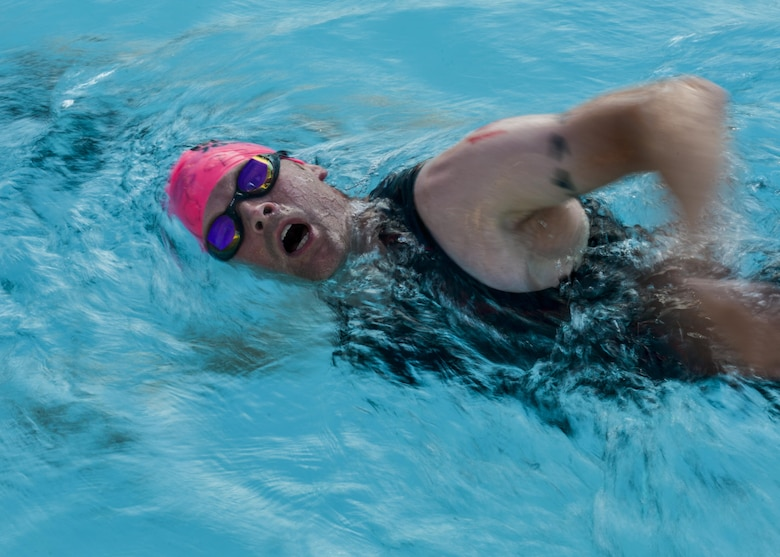 A Team Luke triathlon participant swims during the Luke Triathlon held at Luke Air Force Base, Ariz., Aug. 19, 2017. Athletes swam 400 meters, biked 13 miles and ran 3.1 miles to finish the competition.  (U.S. Air Force photo/Airman 1st Class Caleb Worpel)