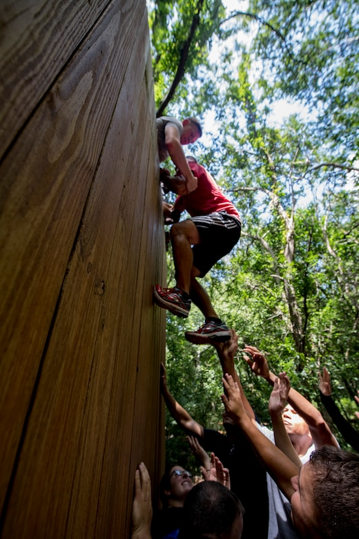 Members of Emerge Moody and Leadership Moody attempt an obstacle during the initial meeting of the 2018 classes, Aug. 18, 2017, at Valdosta State University, Ga.  The Emerge Moody and Leadership Moody courses are designed to nurture the development of leaders throughout the units stationed at Moody Air Force Base. (U.S. Air Force photo by Airman 1st Class Daniel Snider)