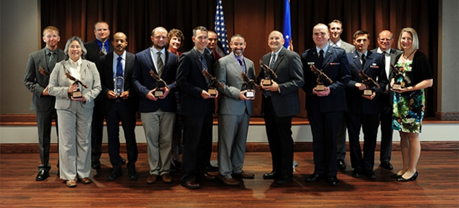 National Air and Space Intelligence Center Commander's Award for Merit winners pose for a group photo, Aug. 15, 2017.  NASIC recognized top performers including the Major General Watson award and Wall of Honor inductees. U.S. Air Force photo by Staff Sgt. Stephanie Longoria)