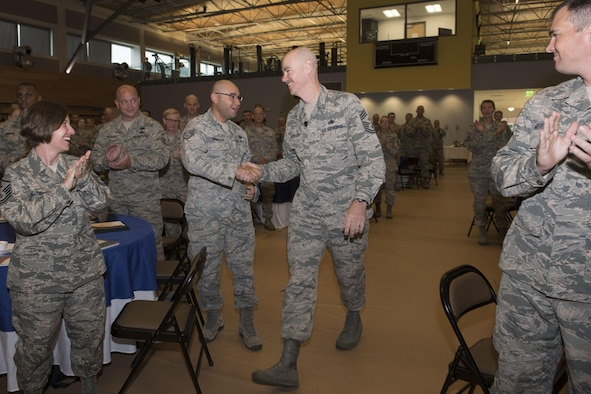 Command Chief of the Air National Guard, Chief Master Ronald C. Anderson greets Airmen as he enters the auditorium for the Enlisted Leadership Symposium at Camp Dawson, W.Va., Aug. 15-17. Nearly 350 Airmen representing Air National Guard units from each state, territory and the District of Columbia, attended the event, hosted by the Command Chief of the Air National Guard, Chief Master Ronald Anderson. The three-day event focused on leadership and professional development. Airmen, non-commissioned officers and senior non-commissioned officers were hand-selected by their units to attend the event. (U.S. Air National Guard photo/Senior Master Sgt. Emily Beightol-Deyerle)