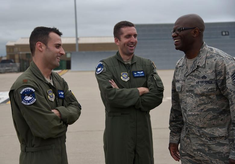Airmen talking on a flightline
