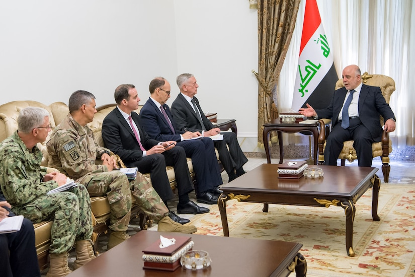 Defense Secretary Jim Mattis sits in a meeting with various leaders.