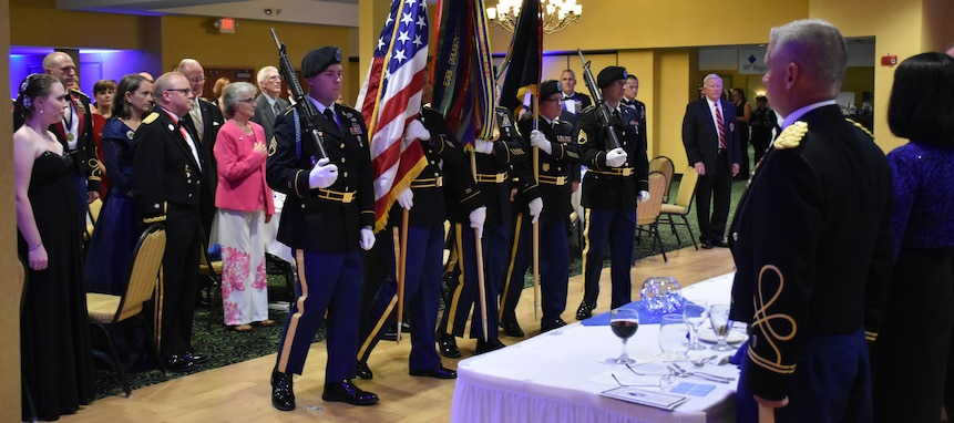 The 88th Blue Devil Color Guard renders honors during an 88th RSC Headquarters and Headquarters Company banquet in Warrens, Wis. on Aug. 19, in honor of the 100 Year Anniversary of the establishment of the 88th Division.