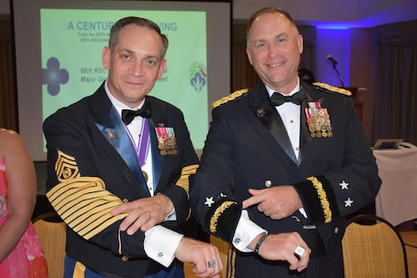 Commanding General of the 88th Regional Support Command Maj. Gen. Patrick Reinert, right, and 88th RSC Command Sgt. Maj. Earl Rocca show off their Blue Devil pride during an 88th RSC Headquarters and Headquarters Company banquet in Warrens, Wis. on Aug. 19, in honor of the 100 Year Anniversary of the establishment of the 88th Division.