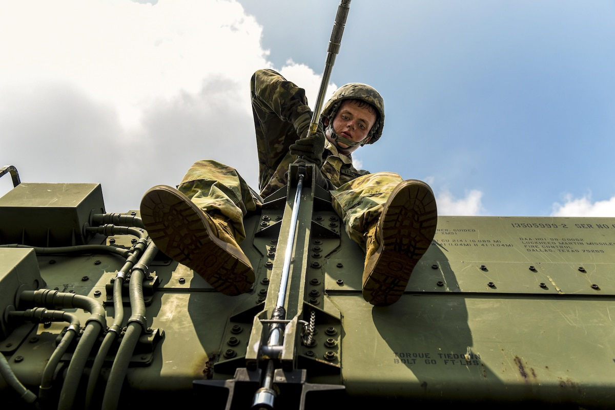 Army Pfc. Tyler Ankele tightens a bolt during Patriot missile system reload training at Kunsan Air Base, South Korea, July 27, 2017. Ankele is a Patriot missile operator and maintainer assigned to Battery A, 2nd Battalion, 1st Air Defense Artillery Regiment. Air Force photo by Senior Airman Michael Hunsaker