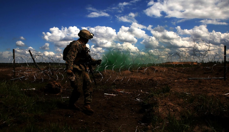 A U.S. Marine with Black Sea Rotational Force 17.1 sets down a detonation cord during an explosive breach drilll aboard Adazi Military Base, Latvia, June 8, 2017. The event was a part of Exercise Saber Strike 17, a multinational training exercise with NATO Allies and partner nations to increase cohesion and skills through combined-arms training (U.S. Marine Corps photo by Cpl. Sean J. Berry)