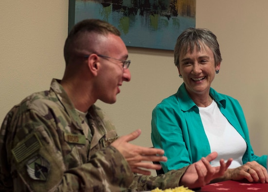 U.S. Air Force Senior Airman Justin Kocis, a radio maintenance specialist with the Joint Special Operations Air Component-Central, speaks with Secretary of the Air Force Heather Wilson at Al Udeid Air Base, Qatar, Aug. 15, 2017.