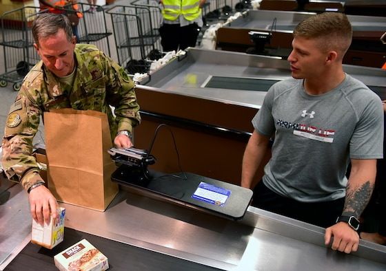 Air Force Chief of Staff Gen. David L. Goldfein bags groceries for an Airman at the commissary on Ramstein Air Base, Germany, Aug. 21, 2017. Gen. Goldfein worked as a bagger at the Ramstein commissary as a teenager. He passed through Ramstein on his way back to the states after visiting Airmen at several locations in the Middle East.