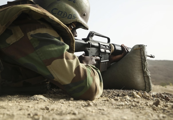 A soldier with Senegal's 5th Contingent in Mali fires an M16A2 rifle during an unknown distance range as part of a peacekeeping operations training mission alongside U.S. Marines with Special Purpose Marine Air-Ground Task Force – Crisis Response – Africa at Thies, Senegal, June 9, 2017. Marines and Sailors with SPMAGTF-CR-AF served as instructors and designed the training to enhance the soldiers' abilities to successfully deploy in support of United Nations peacekeeping missions in the continent. (U.S. Marine Corps photo by Sgt. Samuel Guerra/Released)