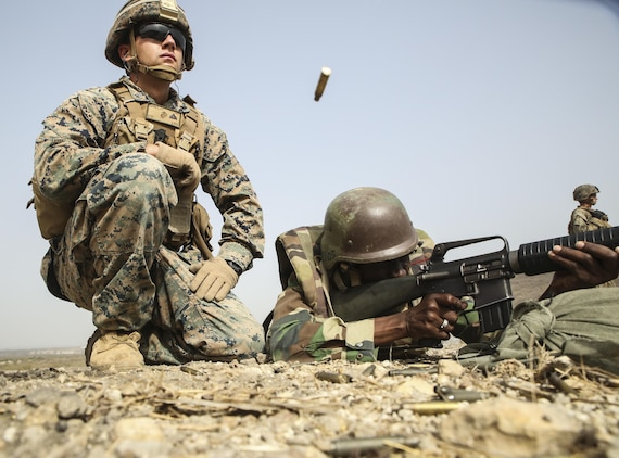 Cpl. Seth Carney, a rifleman with Special Purpose Marine Air-Ground Task Force – Crisis Response – Africa, observes the accuracy of a soldier with Senegal's 5th Contingent in Mali during a peacekeeping operations training mission at Thies, Senegal, June 9, 2017. Marines and Sailors with SPMAGTF-CR-AF served as instructors and designed the training to enhance the soldiers' abilities to successfully deploy in support of United Nations peacekeeping missions in the continent. (U.S. Marine Corps photo by Sgt. Samuel Guerra/Released)