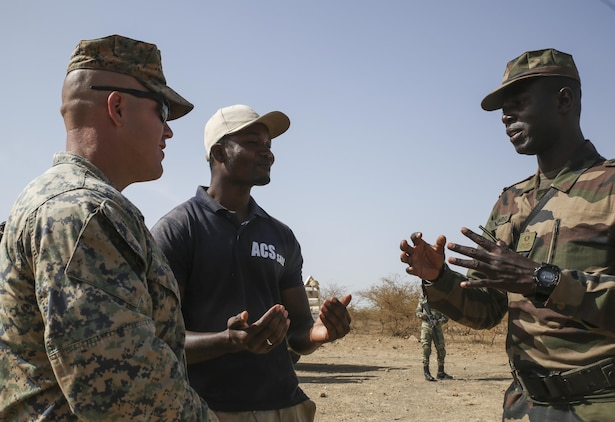Sgt. Joshua Horne, a rifleman with Special Purpose Marine Air-Ground Task Force – Crisis Response – Africa, aides in describing a scenario during the final exercise of a peacekeeping operations training mission at Thies, Senegal, June 13, 2017. Marines and Sailors with SPMAGTF-CR-AF served as instructors and designed the training to enhance the soldiers' abilities to successfully deploy in support of United Nations peacekeeping missions in the continent. (U.S. Marine Corps photo by Sgt. Samuel Guerra/Released)