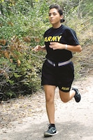 "Warrant Officer Elida Garza, human resources officer, 1st Combat Aviation Brigade, 1st Infantry Division, stays in physical shape by running up ""Demon Hill"" Aug. 10 at Fort Riley, Kansas. Garza believes in being in great physical shape to set the standard for her Soldiers."