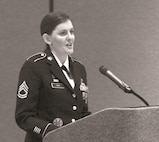 Sgt. 1st Class Jennifer Cox, 1st Infantry Division Sustainment Brigade, speaks at the 1st Warrior Transition Battalion Dining Out Aug. 5 at the Courtyard by Marriott hotel in Junction City, Kansas. Cox was the guest speaker for the first WTB dining out in 10 years.