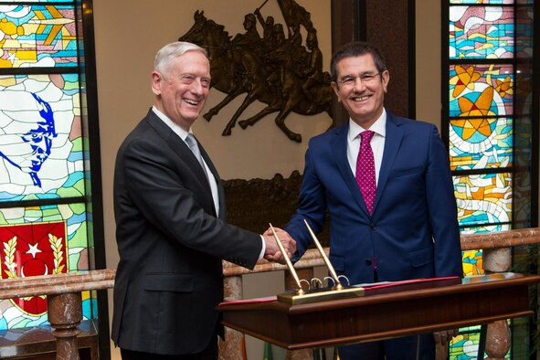 Defense Secretary Jim Mattis shakes hands with Turkey's Defense Minister Nurettin Canikli while in Ankara, Turkey.