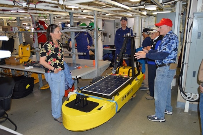 CAPT Tlapa and Chief Scientist explain some of the unmanned maritime systems HEALY tested in the Arctic to the Mayor of Nome and local tribal representatives.