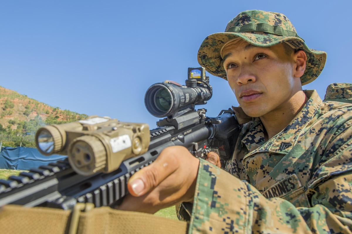 Marine Corps Lance Cpl. Mario Whitman prepares for a battle drill before an exercise in East Timor, July 29, 2017. Whitman is assigned to Fleet Anti-Terrorism Security Team Pacific, a specialized unit that provides a quick-reaction force to protect U.S. assets ranging from embassies to nuclear weapons and submarines across the U.S. 7th Fleet area of operations. Navy photo by Petty Officer 1st Class Martin Wright