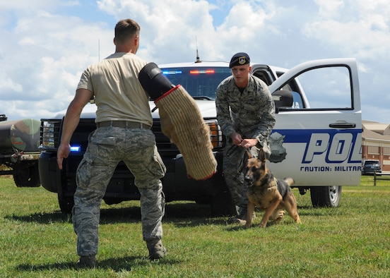 (Left) U.S. Air Force Staff Sgt. Jeffrie Kennedy, 633rd Security Forces Squadron military working dog handler, readies his partner, Toni, 633rd SFS MWD, to attack at Joint Base Langley-Eustis, Va., Aug. 4, 2017.