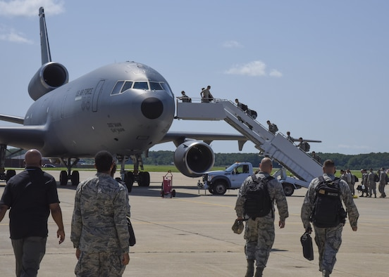 U.S. Air Force Airmen deploying, board a KC-10 Extender at Joint Base Langley-Eustis, Va., Aug. 10, 2017.