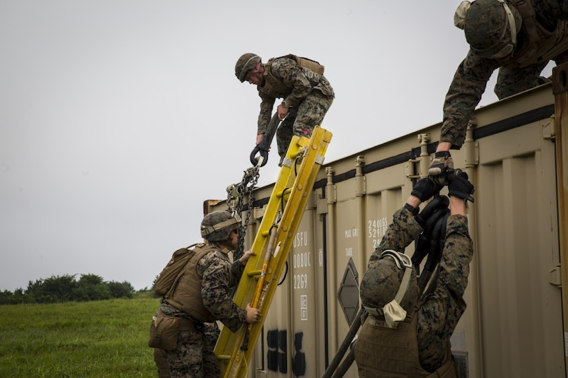 Landing support specialist Marines prepare slings during external lift training in support of exercise Northern Viper 17.
