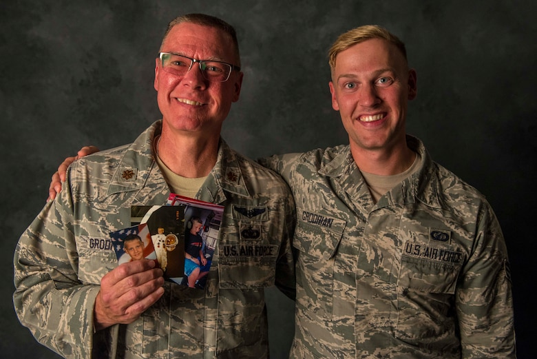 aj. Stanley Grodrian, the flight commander at the Scott Family Health Clinic, and his son, Senior Airman Nathaniel Grodrian, a contracting specialist for the 375th Contracting Squadron, pose for a photo, August 15, 2017, at Scott Air Force Base, Ill.