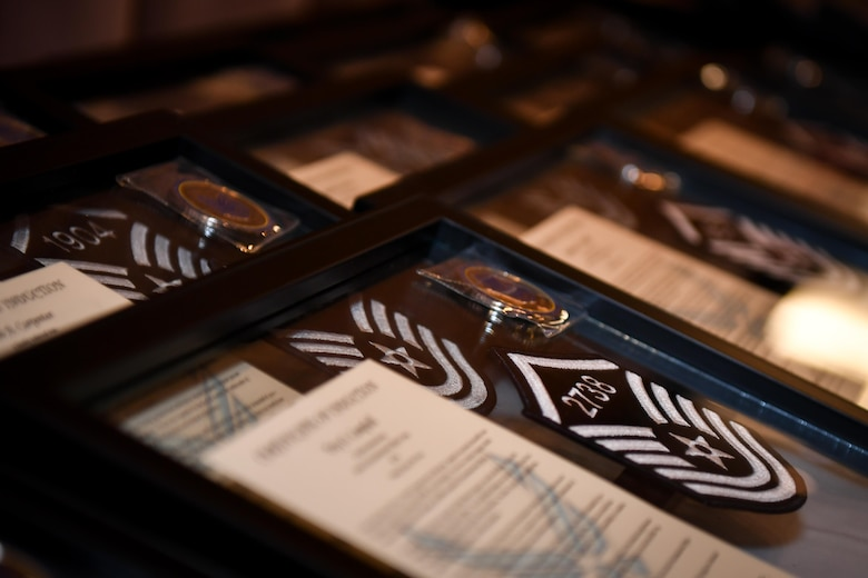 Personalized framed mementos are displayed during the 2017 Senior NCO induction ceremony at Barksdale Air Force Base, La., Aug. 18. The frames included a promotion certificate and personalized coins and master sergeant stripes displaying each inductee's individual line number for promotion.