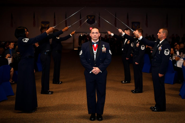 Tech Sgt. Randy Moorhouse, 2nd Logistics and Readiness Squadron Vehicle Operations NCO in charge, poses for a photo after crossing a saber arch during the 2017 Senior NCO induction ceremony at Barksdale Air Force Base, La., Aug. 18. Moorhouse was one of 70 inductees honored during the ceremony, each inductee was introduced as they crossed the saber arch.