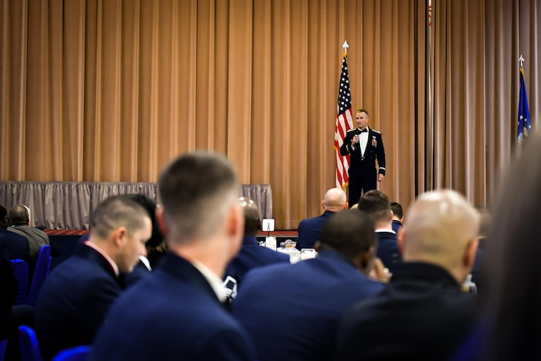 Col. Robert Makros, 2nd Bomb Wing vice commander, speaks to attendees during the 2017 Senior NCO induction ceremony at Barksdale Air Force Base, La., Aug. 18. Makros spoke to inductees about leadership and the balance between taking their families and their Airmen.