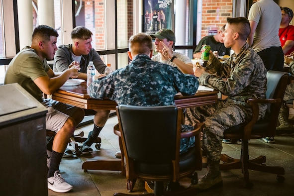 The Scott Air Force Base First Sergeant's Group prepares a meal for dorm residents. The meals are prepared as part of the Dorm Dinner program, which provides dorm residents a home cooked meal and a chance to interact with different organizations on base.
