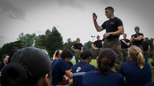 Major Stephen Boada speaks to female poolees and guests during a female pool function at Hanscom Air Force Base, Aug. 18, 2017. The function runs the poolees through an initial strength test to monitor for physical strength progress, exposes them to a brief recruit training experience with a drill instructor, and instructed them on proper long distance running and training. Boada is the commanding officer of Recruiting Station Portsmouth, NH.