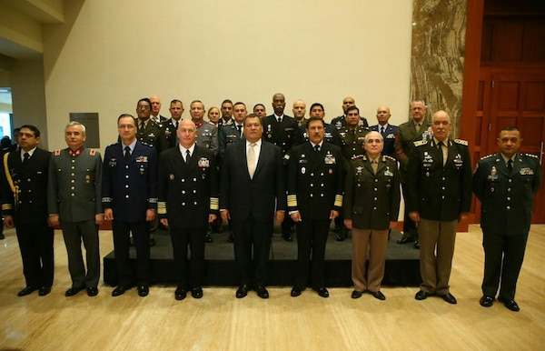 Military leaders representing 9 South American nations and the United States pose for a group photo during the South American Defense Conference in Lima, Peru