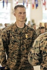 U.S. Marine Corps Sergeant Kelsey with 2nd Battalion, 23rd Marine Regiment, 4th Marine Division, Marine Forces Reserve and Squad Leader of 2nd Squad , stands at attention after recieving the Super Squad Badge during an awards ceremony on Joint Base Elmendorf-Richardson, Alaska, Aug. 9, 2017.