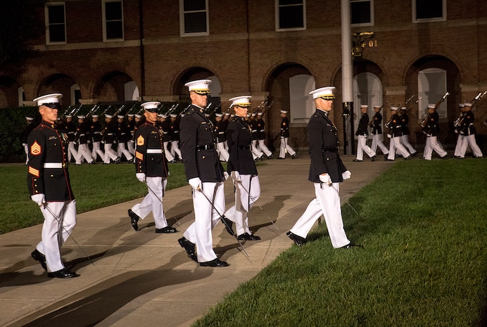 Marines of the parade staff, Marine Barracks Washington D.C., march across the parade deck during a Friday Evening Parade at the Barracks, Aug. 18, 2017. The guest of honor for the parade was the Superintendent of the U.S. Naval Academy, Vice Adm. Walter E. Carter, Jr., and the hosting official was the Deputy Commandant, Combat Development and Integration Commanding General, Marine Corps Combat Development Command, Lt. Gen. Robert S. Walsh. (Official Marine Corps photo by Lance Cpl. Damon McLean/Released)