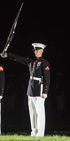 Lance Cpl. Ryan Watkins, rifle inspection team, U.S. Marine Corps Silent Drill Platoon, executes precision rifle drill movements during a Friday Evening Parade at the Barracks, Aug. 18, 2017. The guest of honor for the parade was the Superintendent of the U.S. Naval Academy, Vice Adm. Walter E. Carter, Jr., and the hosting official was the Deputy Commandant, Combat Development and Integration Commanding General, Marine Corps Combat Development Command, Lt. Gen. Robert S. Walsh. (Official Marine Corps photo by Lance Cpl. Damon McLean/Released)