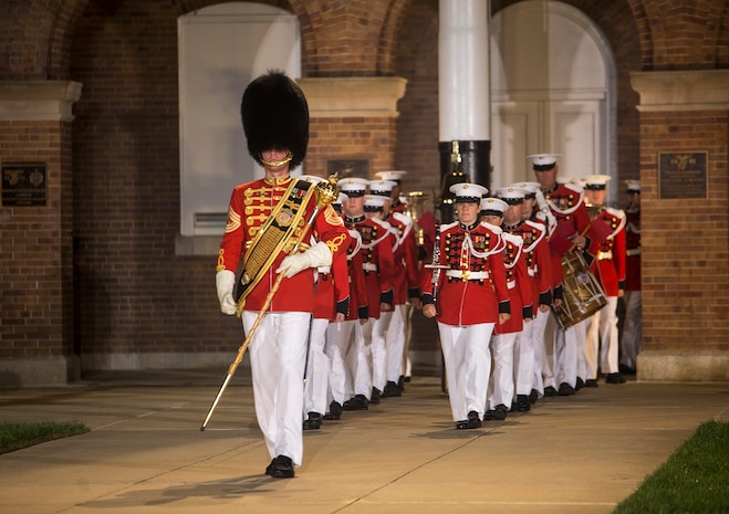 """Master Sgt. Duane F. King, drum major, """"The President's Own"""" U.S. Marine Band marches the band onto the parade deck during a Friday Evening Parade at Marine Barracks Washington D.C., Aug. 18, 2017. The guest of honor for the parade was the Superintendent of the U.S. Naval Academy, Vice Adm. Walter E. Carter, Jr., and the hosting official was the Deputy Commandant, Combat Development and Integration Commanding General, Marine Corps Combat Development Command, Lt. Gen. Robert S. Walsh. (Official Marine Corps photo by Lance Cpl. Damon McLean/Released)"""