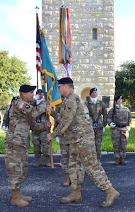 Command Sgt. Maj. Marco A. Torres (left) accepts the Mission and Installation Contracting Command colors from Col. William M. Boruff as color bearer Sgt. 1st Class Quadedra Corey looks on during an assumption-of-responsibility ceremony Aug. 23 at Joint Base San Antonio-Fort Sam Houston, Texas. Boruff is the MICC commander.